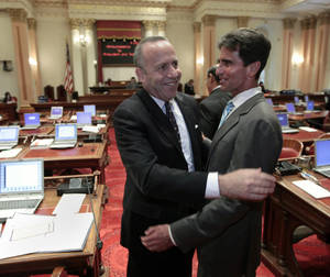 Photo -   Senate President Pro Tem Darrell Steinberg, D-Sacramento, left, and Sen. Mark Leno, D-San Francisco, celebrate after Leno's bill authorizing about $4.5 billion funding for a high-speed rail system was approved by the Senate at the Capitol in Sacramento, Calif., Friday, July 6, 2012. The bill, which would allow the state to begin selling $2.6 billion in voter -approved bonds, passed by a 21-16 vote and now goes to Gov. Jerry Brown who has supports the measure.(AP Photo/Rich Pedroncelli)