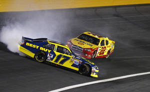 Photo -   Matt Kenseth (17) spins as Sam Hornish Jr (22) tries to drive past during the NASCAR Bank of America 500 Sprint Cup series auto race in Concord, N.C., Saturday, Oct. 13, 2012. (AP Photo/Chuck Burton)
