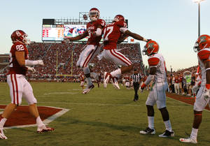 photo - CELEBRATION: Oklahoma's Sterling Shepard (3) celebrates with Oklahoma's Trey Metoyer (17) after a touchdown reception by Metoyer during the college football game between the University of Oklahoma Sooners (OU) and Florida A&M Rattlers at Gaylord Family-Oklahoma Memorial Stadium in Norman, Okla., Saturday, Sept. 8, 2012. Photo by Bryan Terry, The Oklahoman