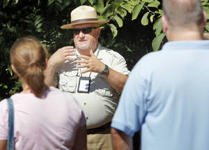 Photo - Naturalist Neil Garrison discusses trees at Little River Park in Moore during a walking tour for children and families on Saturday, June 23, 2012. <strong>NATE BILLINGS - NATE BILLINGS</strong>
