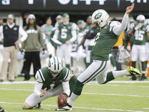 Photo - New York Jets kicker Nick Folk (2) kicks a field goal during the first half of an NFL football game against the New Orleans Saints Sunday, Nov. 3, 2013, in East Rutherford, N.J.  (AP Photo/Mel Evans)