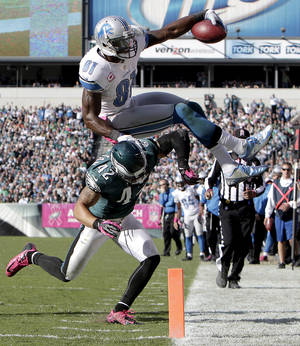 Photo -   Philadelphia Eagles' Kurt Coleman, left, knocks Detroit Lions' Calvin Johnson out of bounds on the 1-yard line during the fourth quarter of an NFL football game, Sunday, Oct. 14, 2012, in Philadelphia. The Lions won 26-23. (AP Photo/Philadelphia Daily News, David Maialetti )