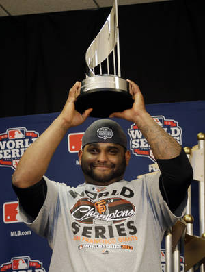 Photo -   San Francisco Giants' Pablo Sandoval holds up his MVP trophy after Game 4 of baseball's World Series against the Detroit Tigers Sunday, Oct. 28, 2012, in Detroit. The Giants won 4-3 to win the series. (AP Photo/Matt Slocum, Pool )