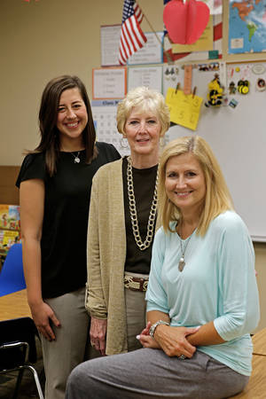 Photo - Taylor Anderson, left, followed in the path of her grandmother Margaret Self and mother, Shelly Anderson,  to teach in Edmond Public Schools. They are pictured in Shelly Anderson's classroom at Northern Hills Elementary in Edmond. Photo by Bryan Terry, The Oklahoman <strong>BRYAN TERRY - THE OKLAHOMAN</strong>