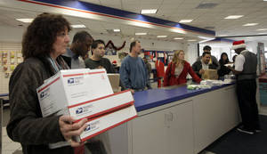 photo -   FILE - This Dec. 19, 2011 file photo shows people in line at the U.S. Postal Service Airport station in Los Angeles. Emboldened by rapid growth in e-commerce shipping, the cash-strapped U.S. Postal Service is moving aggressively this holiday season to start a premium service for the Internet shopper seeking the instant gratification of a store purchase: same-day package delivery. (AP Photo/Nick Ut, File)