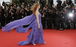 Photo - Actress Jessica Chastain poses for photographers as she arrives for the screening of Foxcatcher at the 67th international film festival, Cannes, southern France, Monday, May 19, 2014. (AP Photo/Thibault Camus)