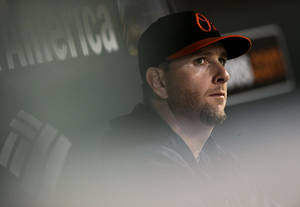 Photo - Baltimore Orioles starting pitcher Scott Feldman watches from the dugout after being relieved in the third inning of a baseball game against the Boston Red Sox, Friday, Sept. 27, 2013, in Baltimore. (AP Photo/Patrick Semansky)
