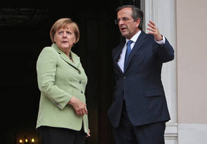 photo -   Greece's Prime Minister Antonis Samaras, right, and Germany's Chancellor Angela Merkel speak before their meeting at the Maximos mansion in Athens, Tuesday, Oct. 9, 2012. Amid draconian security measures and a mass protest, German Chancellor Angela Merkel arrived Tuesday for her first visit to Greece since the eurozone crisis began there three years ago. Her five-hour stop is seen by the Greek government as a historic boost for the country's future in Europe, but by protesters as a harbinger of more austerity and hardship. (AP Photo/Thanassis Stavrakis, Pool)