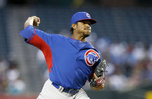 Photo - Chicago Cubs' Edwin Jackson throws a pitch against the Arizona Diamondbacks during the first inning of an exhibition baseball game, Friday, March 28, 2014, in Phoenix. (AP Photo/Ross D. Franklin)