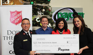 Photo -  Left to right: Captain Carlyle Gargis of The Salvation Army, Jason Bodin, Paycom public relations manager, Jeanean South, Salvation Army director of development and Stacey Pezold, Paycom Executive Vice President of Operations.      <strong></strong>