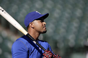 Photo - Texas Rangers' Nelson Cruz takes batting practice with the team before a baseball game against the Tampa Bay Rays, Monday, Sept. 30, 2013, in Arlington, Texas. Cruz was activated on Monday and is scheduled to play in game 163, an American League wild-card tiebreaker game. (AP Photo/Tony Gutierrez)