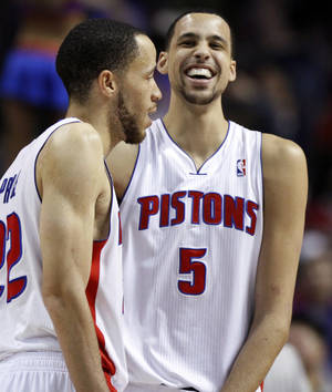 photo - Detroit Pistons forward Austin Daye (5) laughs at a comment from Tayshaun Prince, left, after Daye hit a 3-pointer with the shot clock running out to give the Pistons a 103-97 win over the Sacramento Kings in an NBA basketball game, Tuesday, Jan. 1, 2013, in Auburn Hills, Mich. (AP Photo/Duane Burleson)