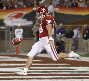 photo - Oklahoma's Tress Way (36) punts the ball during the Insight Bowl college football game between the University of Oklahoma (OU) Sooners and the Iowa Hawkeyes at Sun Devil Stadium in Tempe, Ariz., Friday, Dec. 30, 2011. Photo by Bryan Terry, The Oklahoman