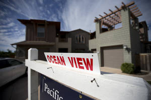 Photo - This Wednesday, Nov. 14, 2012, photo, shows a home for sale in Leucadia, Calif.. U.S. home prices accelerated in November compared with a year ago, pushed higher by rising sales and a tighter supply of available homes (AP Photo/Gregory Bull)