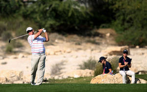 Photo - George Coetzee of South Africa hits his tee shot on the 7th hole during the first round of the Commercial Bank Qatar Masters at the Doha Golf Club in Doha, Qatar, Wednesday, Jan. 22, 2014. (AP Photo/Osama Faisal)