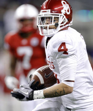 Photo - Oklahoma's Kenny Stills (4) makes more yards up field after a reception during the Big 12 football championship game between the University of Oklahoma Sooners (OU) and the University of Nebraska Cornhuskers (NU) at Cowboys Stadium on Saturday, Dec. 4, 2010, in Arlington, Texas.  Photo by Chris Landsberger, The Oklahoman