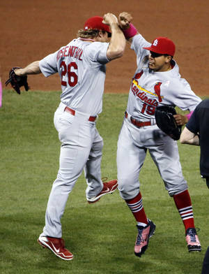 Photo - St. Louis Cardinals' Jon Jay celebrates with closer Trevor Rosenthal (26) after getting the final out in the ninth inning of a baseball game against the Pittsburgh Pirates in Pittsburgh, Sunday, May 11, 2014. The Cardinals won 6-5. (AP Photo/Gene Puskar)
