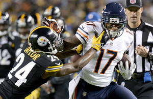 Photo - Chicago Bears wide receiver Alshon Jeffery (17) is hit by Pittsburgh Steelers cornerback Ike Taylor (24) after making a catch in the third quarter of an NFL football game on Sunday, Sept. 22, 2013, in Pittsburgh. (AP Photo/Don Wright)