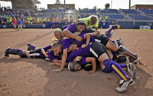 Photo - Members of the Red Oak softball team celebrate their 8-6 win over Leedey during the Class A state championship softball tournament at ASA Hall of Fame Stadium on Wednesday, May 2, 2012, in Oklahoma City, Oklahoma. Photo by Chris Landsberger, The Oklahoman