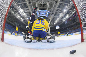 Photo - Lyndsey Fry of the United States celebrates Megan Bozek's goal as Goalkeeper Valentina Wallner of Sweden sits on her knees during the second period of the 2014 Winter Olympics women's semifinal ice hockey game at Shayba Arena, Monday, Feb. 17, 2014, in Sochi, Russia. (AP Photo/Bruce Bennett, Pool)