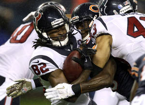 Photo -   Houston Texans wide receiver Keshawn Martin (82) is tackled by Chicago Bears defensive back Zack Bowman during the first half of an NFL football game, Sunday, Nov. 11, 2012, in Chicago. (AP Photo/Nam Y. Huh)