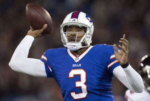 Photo - Buffalo Bills quarterback EJ Manuel launches a pass against the Atlanta Falcons during first half NFL football action in Toronto on Sunday Dec. 1, 2013. (AP Photo/The Canadian Press, Frank Gunn)