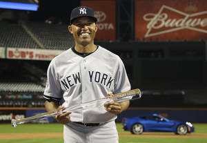 Photo - American League's Mariano Rivera, of the New York Yankees,  poses with the MVP trophy after the MLB All-Star baseball game, on Tuesday, July 16, 2013, in New York. The American League defeated the National League 3-0. (AP Photo/Matt Slocum)
