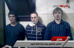 Photo -   In this image from Egyptian state television broadcast Tuesday Nov 22 2011, three American students are displayed to the camera by Egyptian authorities following their arrest during protests in Cairo, where an Egyptian official said they were throwing firebombs at security forces. A spokeswoman for the American University in Cairo identified the students as Luke Gates, a 21-year-old Indiana University student from Bloomington, Ind.; Derrik Sweeney, a 19-year-old Georgetown University student from Jefferson City, Mo.; and Gregory Porter, a 19 year-old Drexel University student from Glenside, Pa.(AP Photo/ Egyptian TV)
