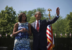 photo -   President Barack Obama and first lady Michelle Obama at the Vietnam Memorial on the National Mall in Washington, Monday, May 28, 2012. (AP Photo/Pablo Martinez Monsivais)