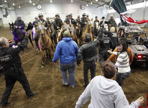 Photo - Oklahoma County deputies and their horses receive training in crowd control March 2 at State Fair Park in Oklahoma City. Photo By Paul Hellstern, The Oklahoman