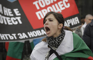 "Photo - A Bulgarian woman shout slogans during a protest against higher electricity and heating bills, in Sofia,  Sunday, Feb. 17, 2013. Thousands of angry Bulgarians chanted ""mafia"" and ""resignation""  demanded the expulsion of the three foreign-controlled power distributors that control the local market: Czech Republic's CEZ and Energo-Pro, and Austria's EVN   (AP Photo/Valentina Petrova)"