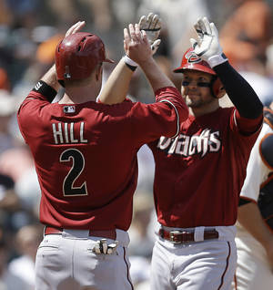 Photo - Arizona Diamondbacks' Cody Ross, right, is congratulated by Aaron Hill (2) after Ross hit a two-run home run against the San Francisco Giants in the seventh inning of a baseball game Sunday, July 13, 2014, in San Francisco. (AP Photo/Ben Margot)
