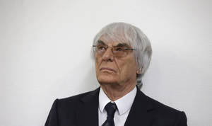Photo - Formula One boss Bernie Ecclestone arrives for his trial in the regional court in Munich, southern Germany, Tuesday, Aug.5, 2014. German prosecutors said Tuesday that they will accept dropping the bribery case against Ecclestone in exchange for a US dollar 100 million payment by the Formula One boss, and judges were considering whether to close his trial. Ecclestone went on trial at the Munich state court in late April on charges of bribery and incitement to breach of trust — which could, if he were convicted, carry a sentence of up to 10 years in prison. (AP Photo/Matthias Schrader)