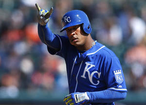 Photo - Kansas City Royals' Salvador Perez signals the bench after hitting a double against the Detroit Tigers in the eighth inning of a baseball game in Detroit, Wednesday, April 2, 2014. (AP Photo/Paul Sancya)
