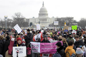 Photo - People walk from the U.S. Capitol to the Washington Monument in Washington, Saturday, Jan. 26, 2013, during a march on Washington for gun control. (AP Photo/Susan Walsh)