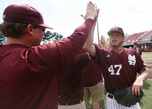 Photo - Mississippi State pitcher Myles Gentry (47) celebrates with coach John Cohen after an NCAA college baseball tournament regional game against San Diego State in Lafayette, La., Friday, May 30, 2014. Mississippi State won 5-2. (AP Photo/Jonathan Bachman)
