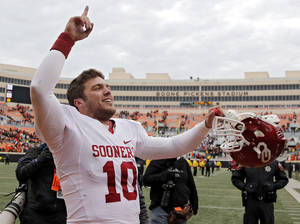 Photo - OU quarterback Blake Bell celebrates after the Sooners' Bedlam win in Stillwater.  Photo by Chris Landsberger, The Oklahoman