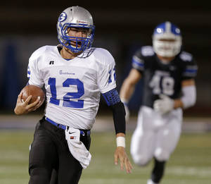 Photo - Guthrie's Reed Roberts runs against Deer Creek during a high school football game at Deer Creek in Oklahoma City, Friday, October 25, 2013. Photo by Bryan Terry, The Oklahoman
