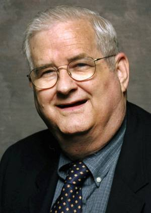 """Photo - In this photo taken in 2001 and provided by ESPN, college football commentator Carroll """"Beano"""" Cook is shown. Cook died in his sleep Thursday, Oct. 10, 2012, the University of Pittsburgh announced. The 81 year-old commentator had worked for the sports network since 1986 and was the sports information director at his alma mater, the University of Pittsburgh, from 1956 to 1966. (AP Photo/ESPN)"""