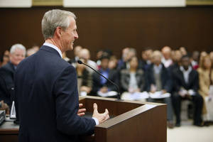 Photo - John Richels, Devon Energy Corp. CEO, speaks Friday at a naturalization ceremony at the federal courthouse in Oklahoma City as he and 101 others were sworn in as U.S. citizens. Photo by Paul Hellstern, The Oklahoman