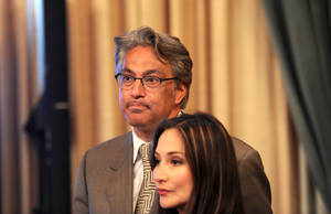 Photo -   Suspended San Francisco Sheriff Ross Mirkarimi and his wife Eliana Lopez wait for the Board of Supervisors to convene on Tuesday, Oct. 9, 2012, in San Francisco. The Board planned to vote on removing Mirkarimi, who pled guilty to a misdemeanor charge in a domestic violence case, from office. (AP Photo/Noah Berger)