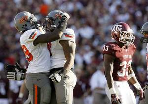 photo - Oklahoma State&#039;s Nigel Nicholas (89) and Richetti Jones (99) celebrate a play in the second half during a college football game between the Oklahoma State Cowboys (OSU) and the Texas A&amp;M Aggies at Kyle Field in College Station, Texas, Saturday, Sept. 24, 2011. Photo by Sarah Phipps, The Oklahoman  ORG XMIT: KOD