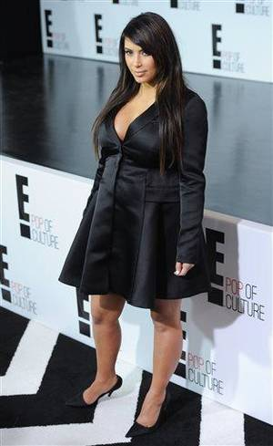 "Photo - Kim Kardashian from ""Keeping Up With The Kardashians"" attends the E! Network 2013 Upfront at the Manhattan Center on Monday April 22, 2013 in New York. (Photo by Evan Agostini/Invision/AP)"