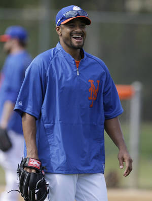 photo - New York Mets starting pitcher Johan Santana reacts during a spring training baseball workout, Thursday, Feb. 21, 2013, in Port St. Lucie, Fla. (AP Photo/Julio Cortez)