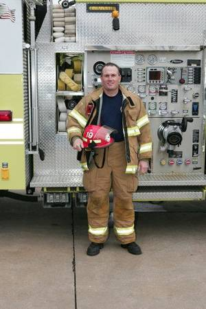 Photo - SHOOTING DEATH: Devin Nemecek, 47, a retired Yukon firefighter, was killed Tuesday, April 19, 2011, in a shooting at 317 Sunrise Drive in Yukon, police said. An off-duty Piedmont police officer shot Nemecek as Nemecek barged into the officer's Yukon home and attacked him. Nemecek's family said he suffered lung and heart problems while injured on the job and used oxygen to breathe. Nemecek's family said they think he was having hallucinations due to low oxygen levels and was confused when he barged into the officer's home. Provided by Yukon police.        ORG XMIT: 1104192228193571