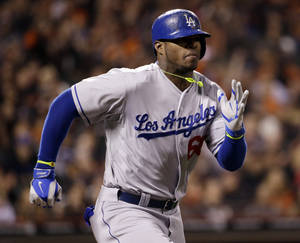 Photo - Los Angeles Dodgers' Yasiel Puig runs to first base as he grounds out during the eighth inning of a baseball game on Wednesday, April 16, 2014, in San Francisco. San Francisco won 2-1. (AP Photo/Marcio Jose Sanchez)