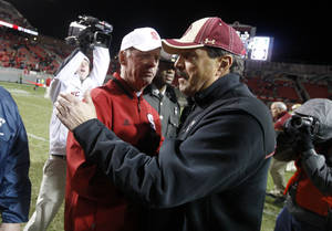 Photo -   North Carolina State coach Tom O'Brien, left, greets Boston College coach Frank Spaziani after N.C. State's 27-10 victory in an NCAA college football game Saturday, Nov. 24, 2012, in Raleigh, N.C. (AP Photo/The News & Observer, Ethan Hyman) MANDATORY CREDIT