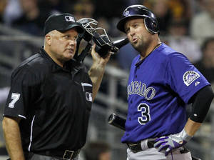 Photo -   Colorado Rockies' Michael Cuddyer has the attention of home plate umpire Brian O'Nora as he disputes the called third strike call that came with two runners on base during the sixth inning of a baseball game Monday, May 7, 2012 in San Diego. (AP Photo/Lenny Ignelzi)