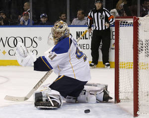 Photo - A shot by New York Rangers left wing Rick Nash sails by St. Louis Blues goalie Jaroslav Halak, of the Czech Republic, and wide of the goal during the second period of an NHL hockey game at Madison Square Garden in New York, Thursday, Jan. 23, 2014.  (AP Photo/Kathy Willens)