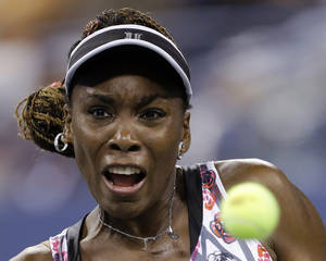 Photo -   Venus Williams returns a shot to Angelique Kerber, of Germany, during a match at the U.S. Open tennis tournament Thursday, Aug. 30, 2012 in New York. (AP Photo/Darron Cummings)